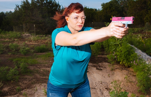 woman pink gun