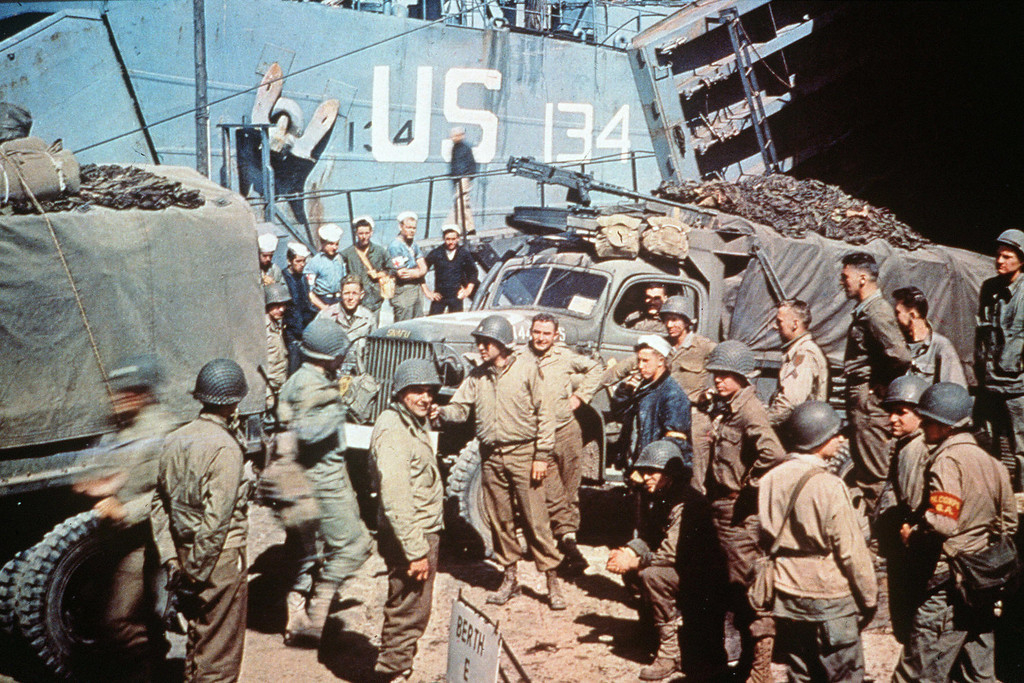 US soldiers gather around trucks disemba