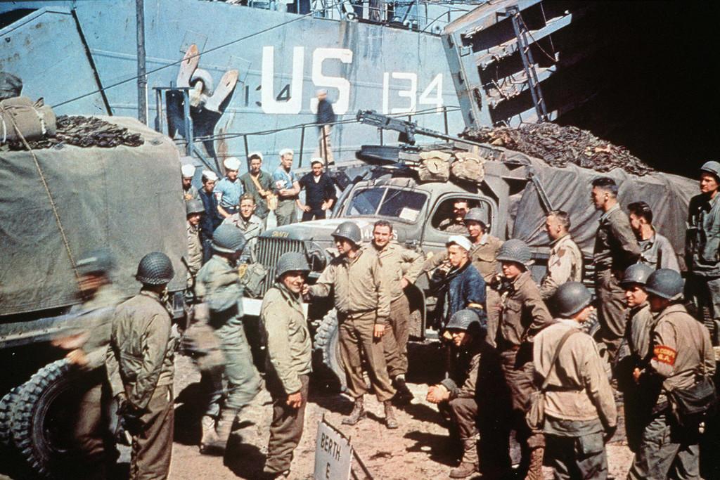 US soldiers gather around trucks disemba